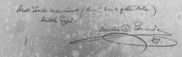 """Amelia Edwards' handwriting on the back of the watercolour painting. This reads: """"Arab tombs near Siout (East Bank of the Nile) Middle Egypt. Amelia B Edwards 1877"""""""